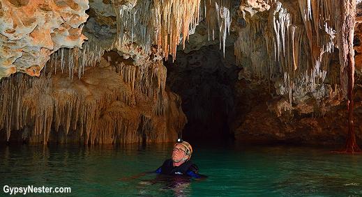 David floats down Rio Secreto in Playa del Carmen, Mexico! GypsyNester.com