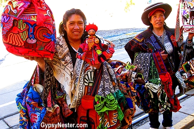 Ladies hawking their wares at the train station to Machu Picchu