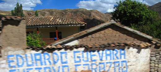 Many homes sport advertising on the outer walls facing the road. Signs for politicians seem to be most prevalent.