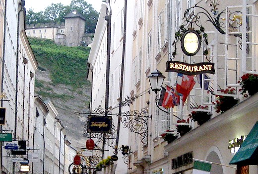 Charming Salzburg street with guild signs