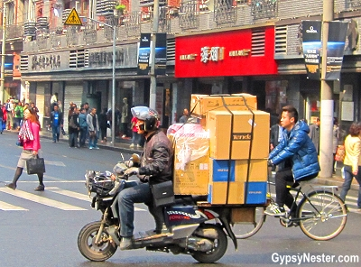 Man carrying an insane amount of cargo on his scooter