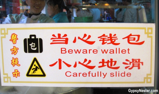 Funny sign at Nanxiang Steamed Bun Restaurant in Shanghai China's Old City