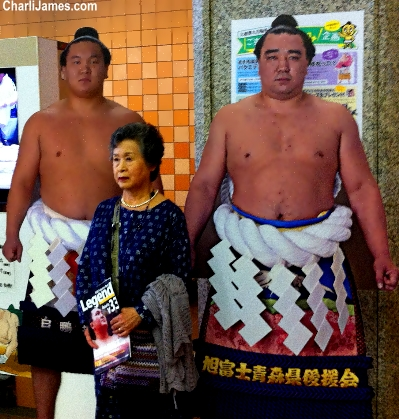 Woman poses with Somu wrestlers in Tokyo, Japan