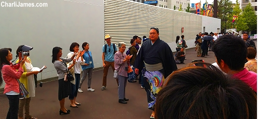 Sumo Wrestlers arrive at the match in Tokyo Japan