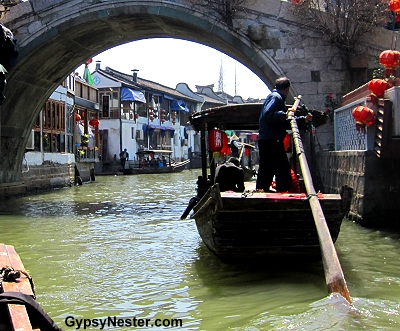 Boats and bridges on the canals of the water town of Zhujiajiao, China near Shanghai