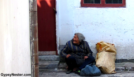 An old woman in the water town of Zhujiajiao, China near Shanghai