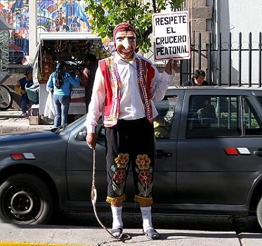 WHOA! Would you jaywalk if THIS guy was standing guard? Yes, that's a whip in his hand!