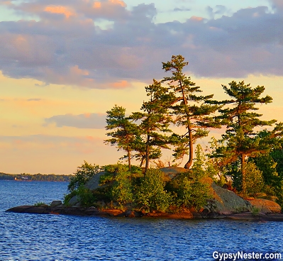 The criteria to be an island in the 1000 Islands is to have at least two trees, be above water year 'round, and no less than a square meter. Whew! This guy barely squeaks by!