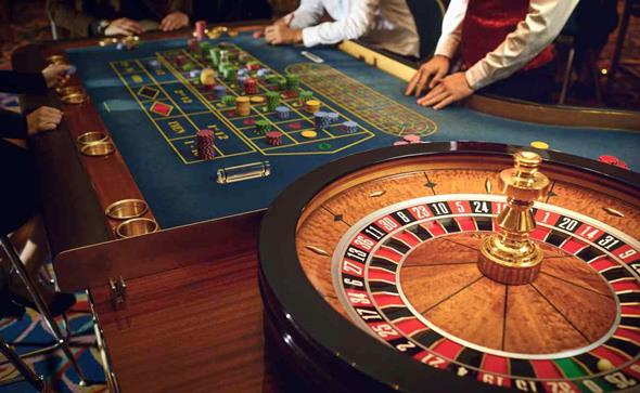People gambling at a roulette table